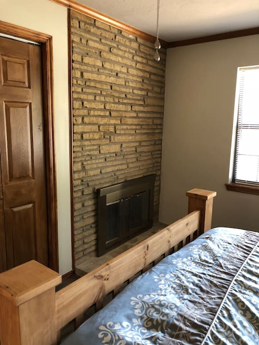 Few places in OKC that offer a fireplace in this master bedroom
