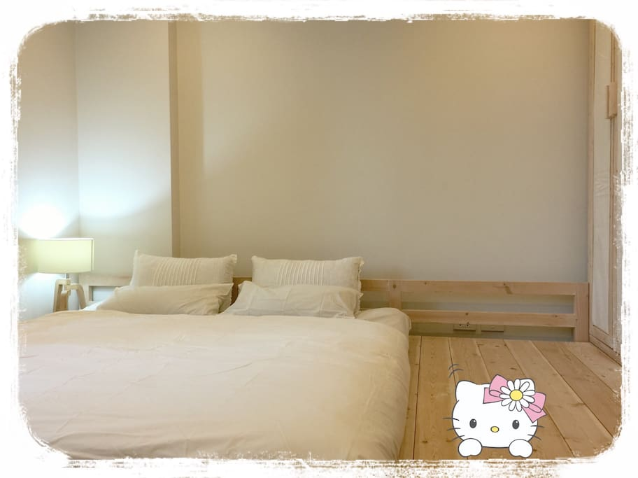 One king mattress in the bed room, decorated with hinoki pine tree wood ( aroma wood)