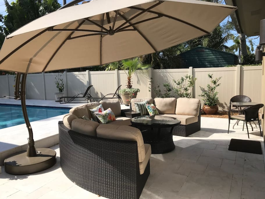New patio furniture and an oversize arching patio umbrella.