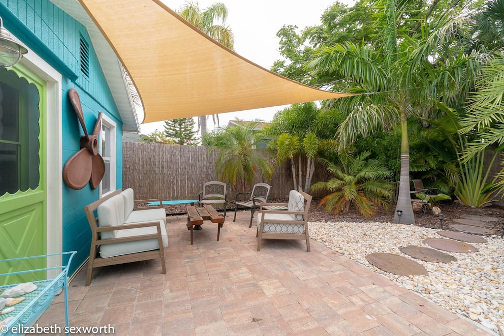 This patio is accessed either directly from the master bedroom (green door in the left side of photo) or from the boardwalk patio deck on the side of the house