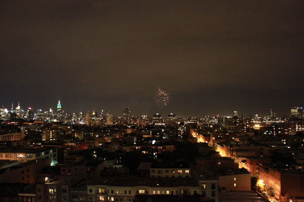 140 sqft balcony with direct NYC views (night - midtown).
