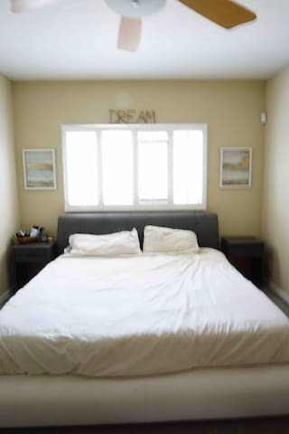Bedroom with comfy Tuft & Needle memory foam bed.