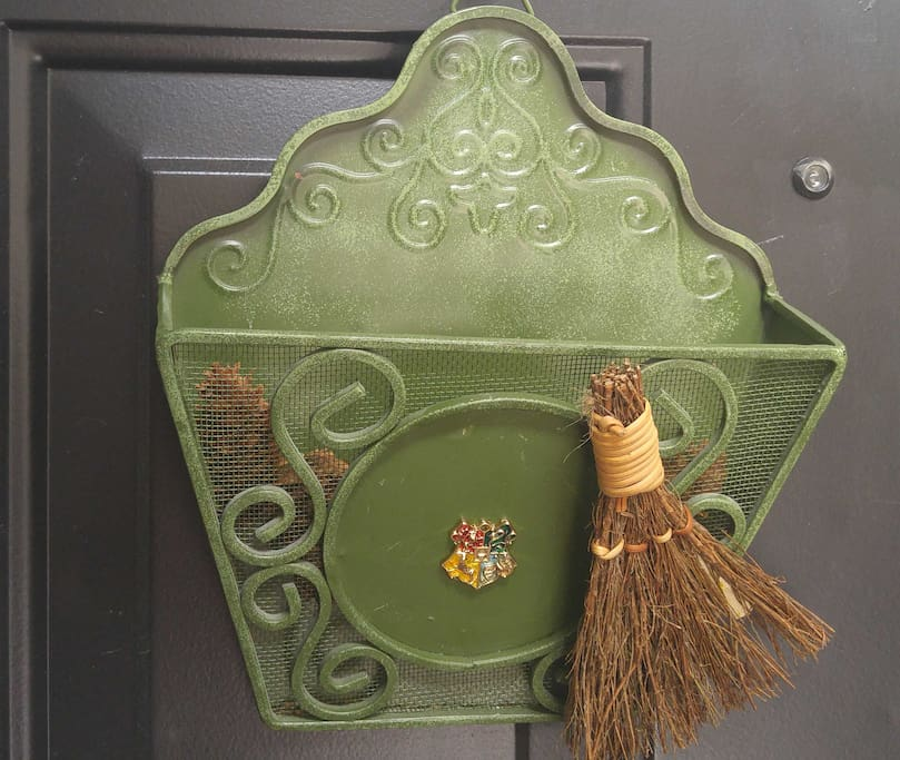 Envelope holder on Front door has Hogwarts Crest
