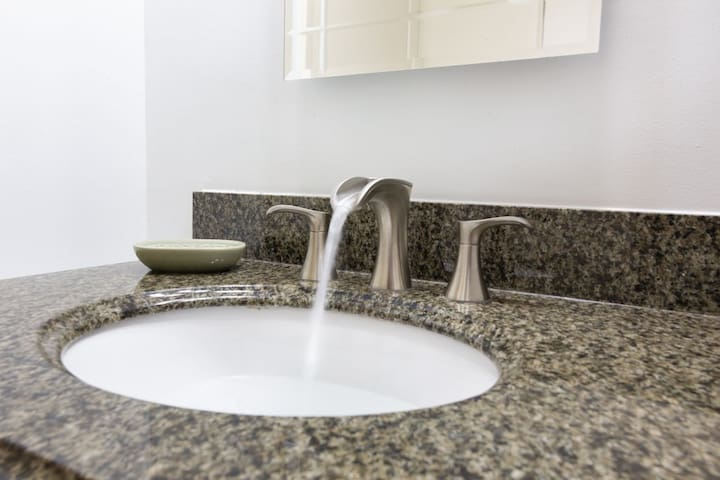 Bathroom fountain faucet with granite sink top