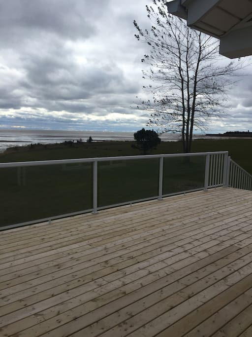 Nice big deck over looking the ocean, with lots of room for BBQ and relaxing.