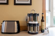 We even include toaster, olive oil, salt and pepper, and spice rack!
