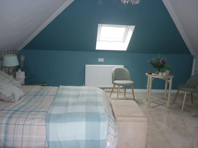 Extremely spacious bedroom with far reaching reviews of Dartmoor.