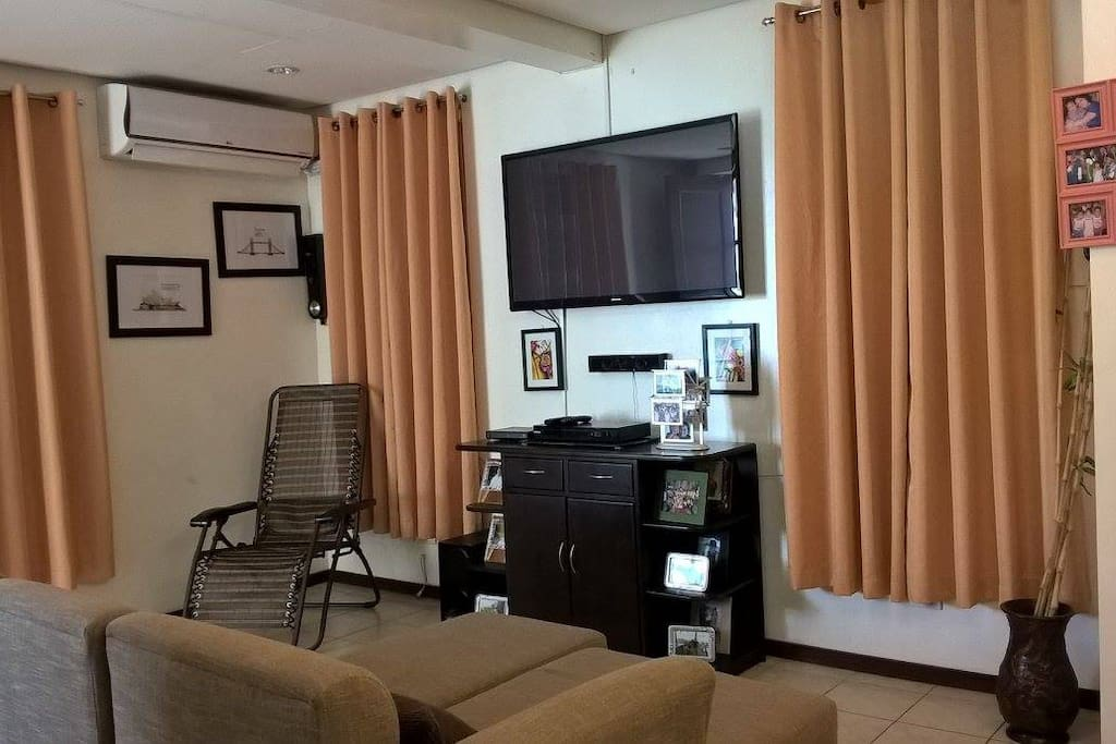 Living room with cable TV and Entertainment System.