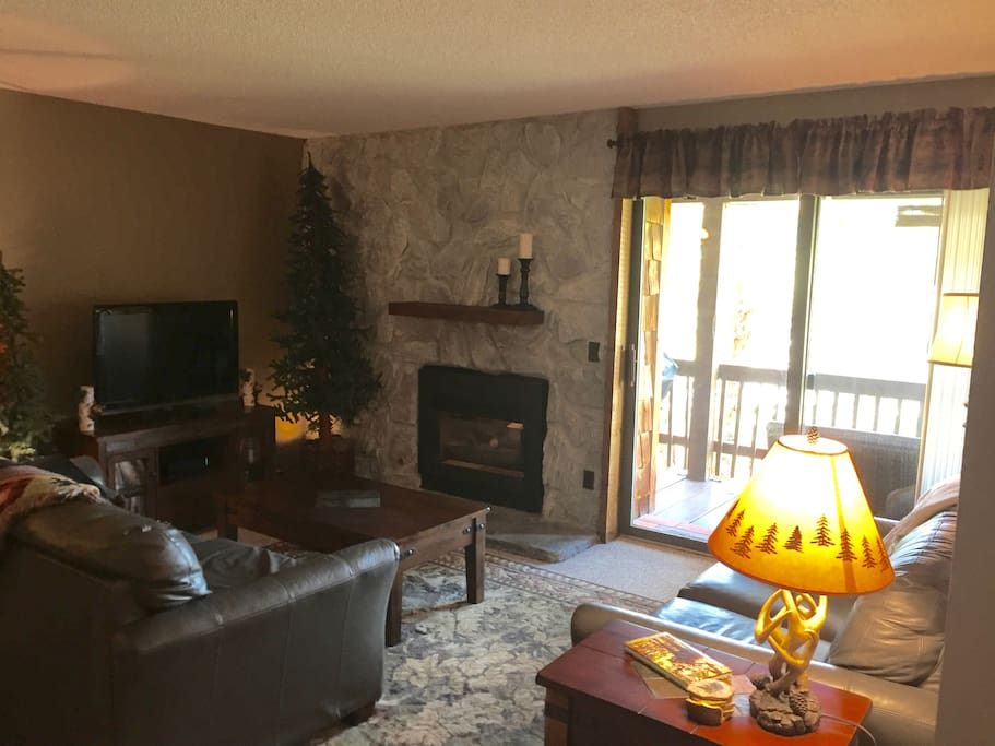 Relax in our cozy living room with gas fireplace