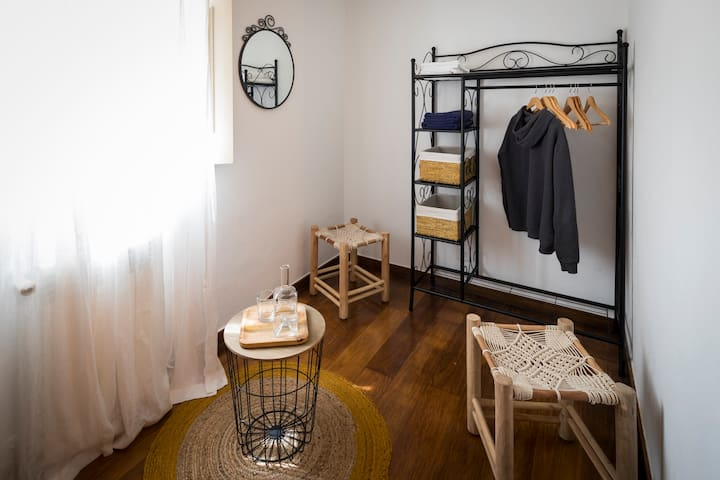 Open wardrobe and table