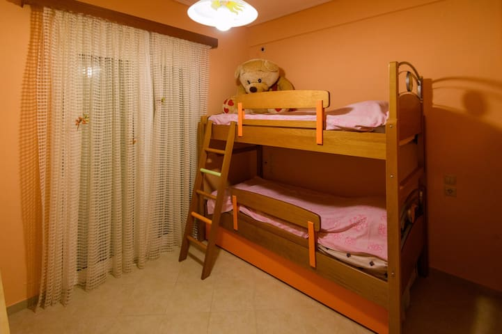 Orange bedroom in second level- 3 beds (twin bunk beds with pull out bed) / Balcony with side sea view