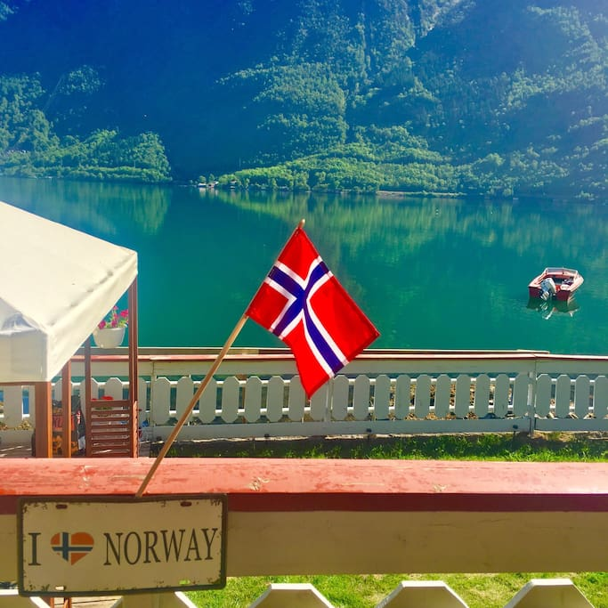Amazing view of the fjord right infront of our apartment. Guests can access this area where in you can sit, grill or just relaxing and feel the spirit of the Norwegian fjord.