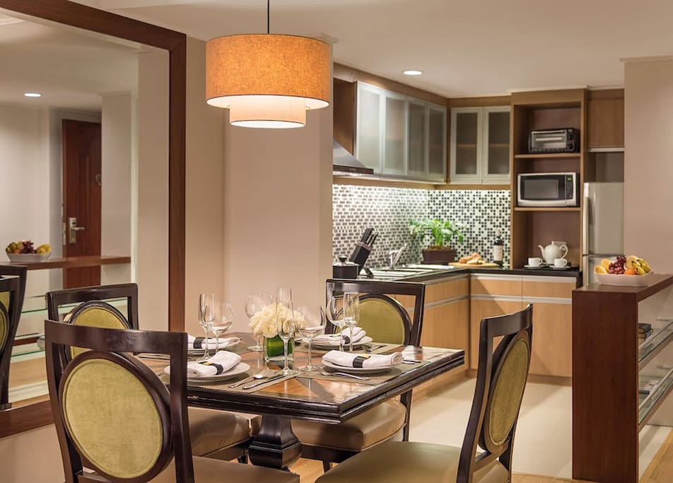 The dining room has a table that can sit up to 4 guests with dinnerware sets and a fully-equipped kitchen.
