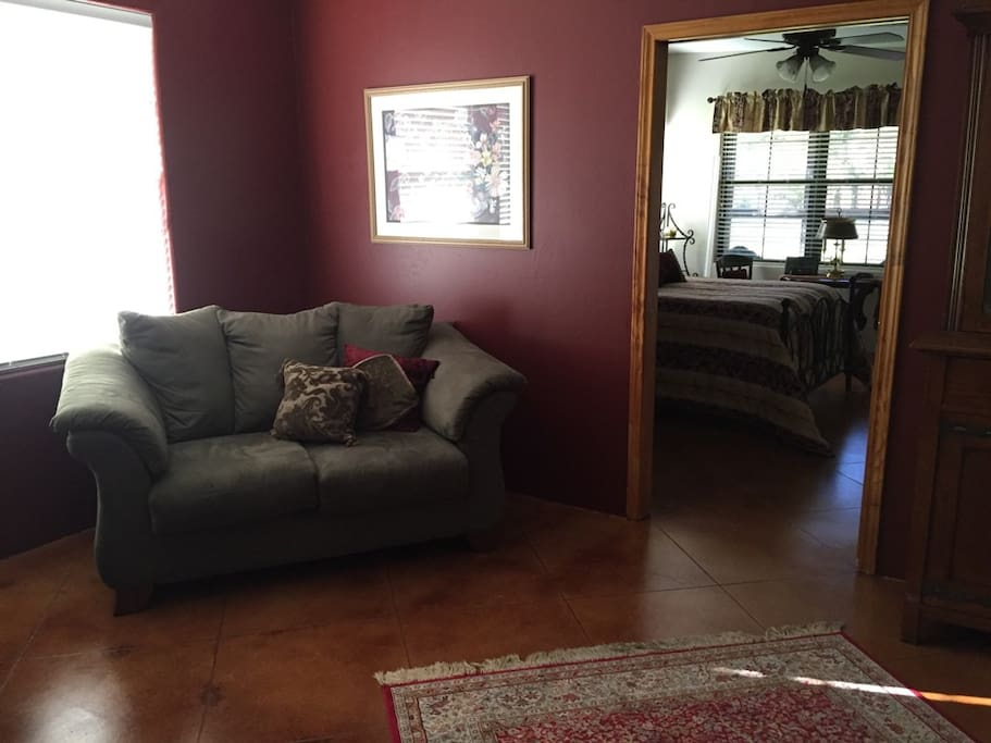 Sitting room with large overstuffed love seat and chair