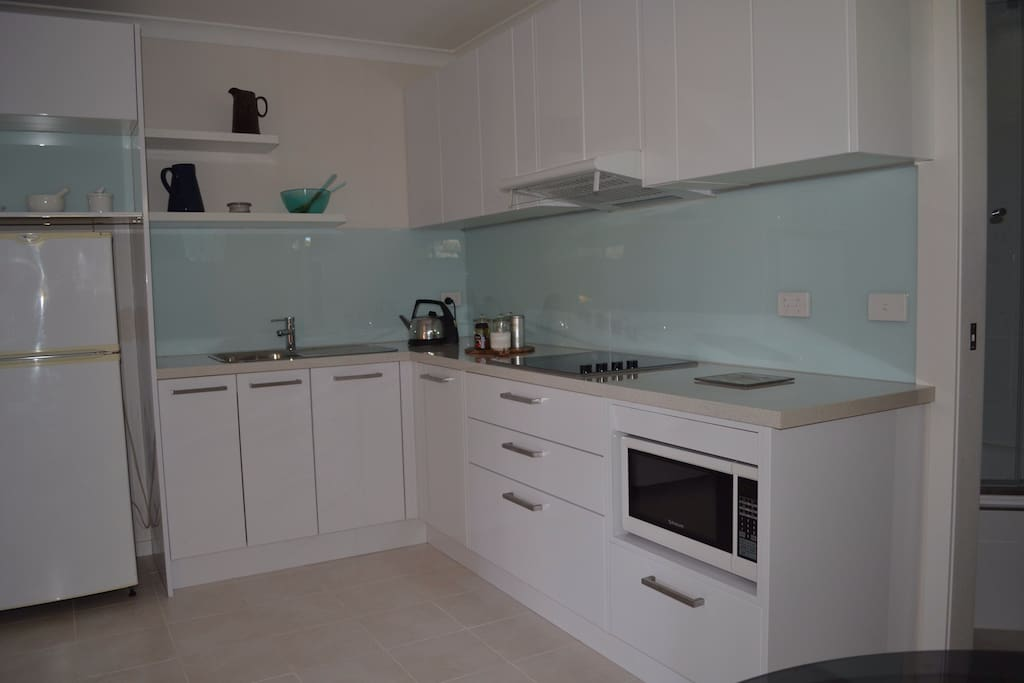 Your self contained kitchen has a full range of appliances, crockery and cutlery and dining table.