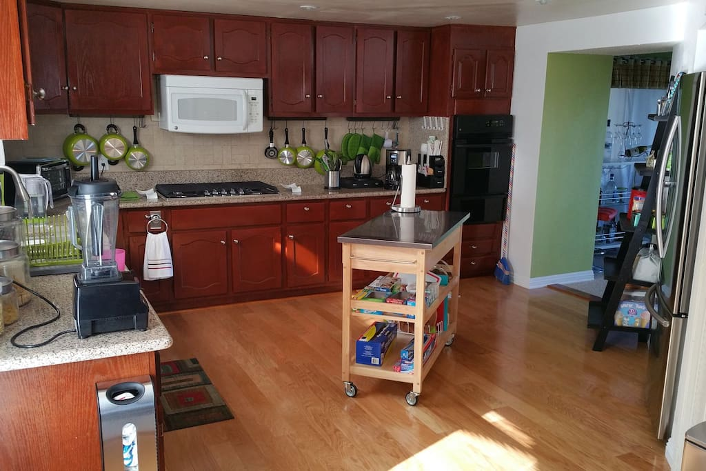 A gigantic kitchen with room for 3 or 4 cooks. A large gas range and oversize fridge.