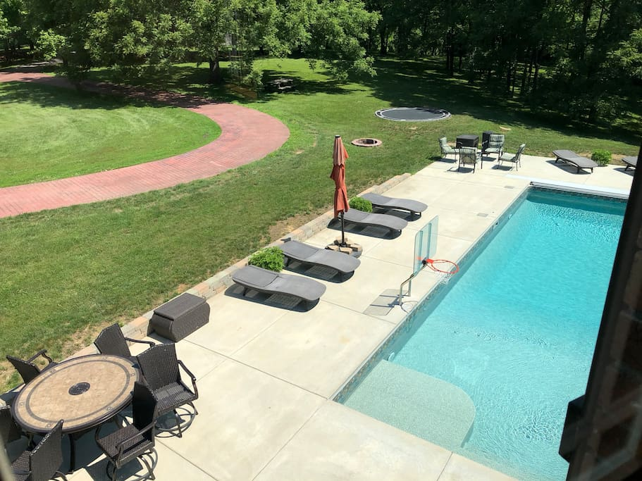 Pool, fire pit and trampoline from upstairs bedroom