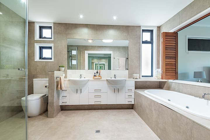 Master ensuite  with toilet, dual basins, shower and large spa bath. Recently refurbished.  A range of bathroom products are supplied