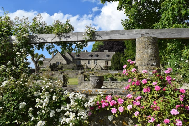 Cotswold Tudor Manor House with swimming pool.