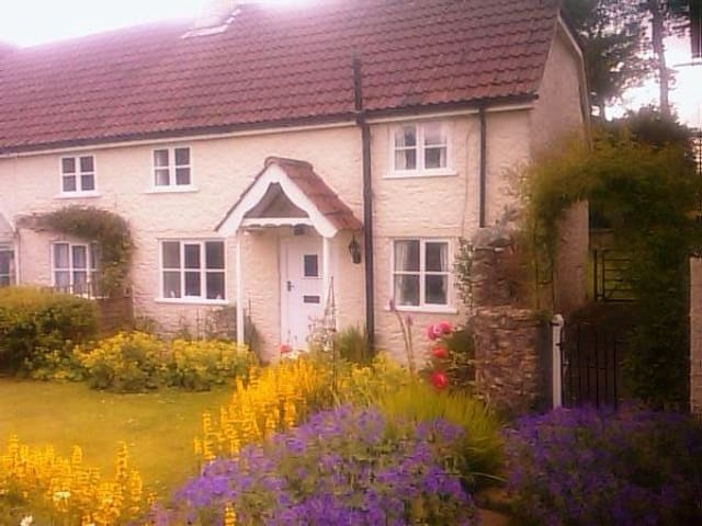 Picturesque Grade 2 listed semi-detached Cottage