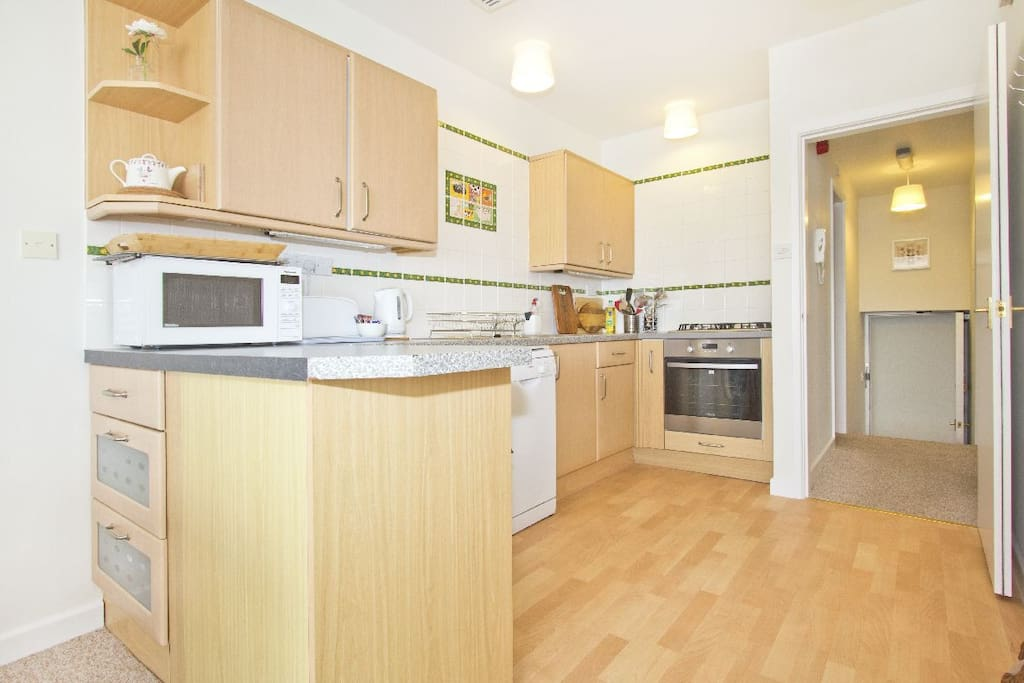 Kitchen is fully equipped with gas hob, electric oven, microwave and cooking utensils