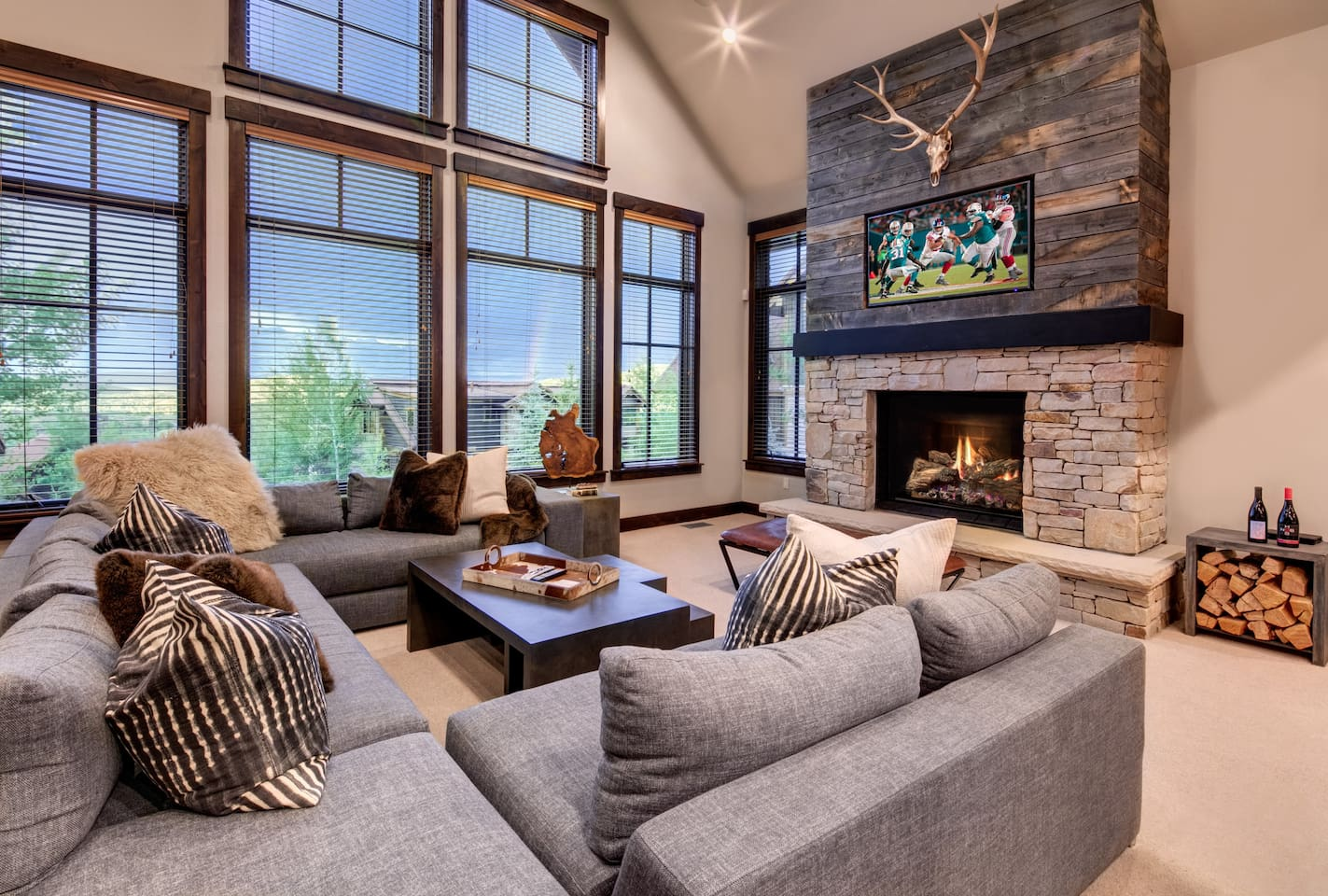 Great room with HDTV, fireplace, and amazing views out to Round Valley and the Uintas