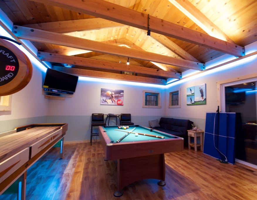 Game room with pool table, ping-pong, darts, shuffle board, foosball, and more.