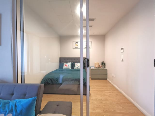 There is a double bed in the second bedroom, which has clear glass screen door, for excellent sound proofing