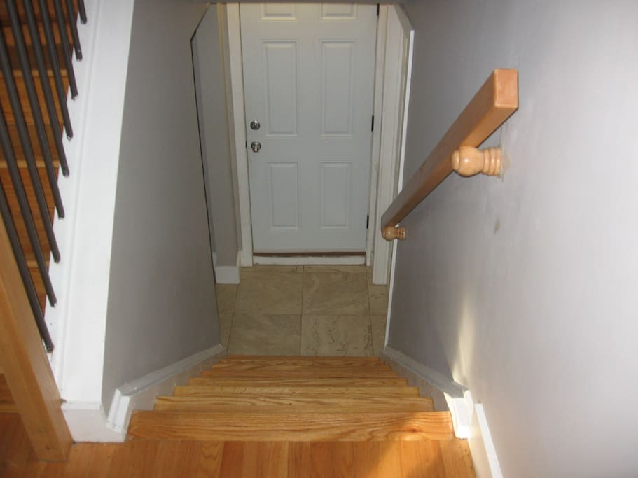 The stairway to enter the in-law suite