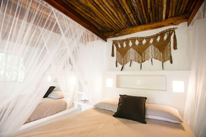 2 Queen Beds room in Garden at Beachfront hotel