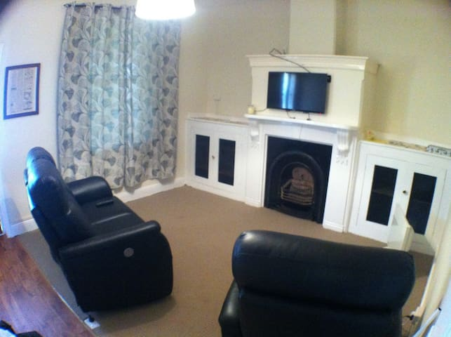 Lounge Room - electric reclining lounge chairs, DVD player and Television.