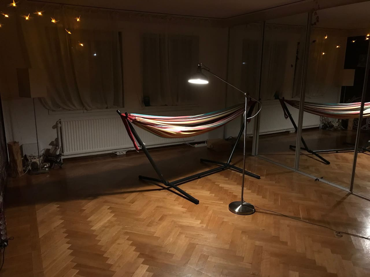 There is a room with a hammock and the morning sun when there is any, that can easily get a company of a couple of light beds. Not much privacy since there is no wall to the rest of the house, and mirrors are about dancing, not playing....