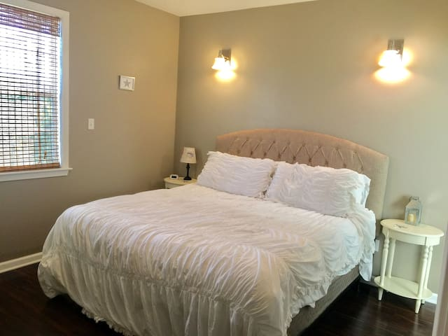 Master bedroom with comfy king bed and private bathroom and walk-in closet.