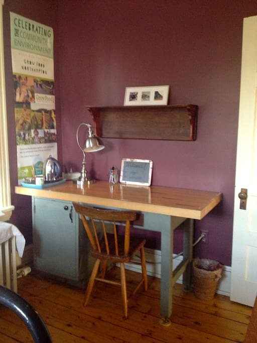 Large, functional desk; kettle for hot water; assorted teas.