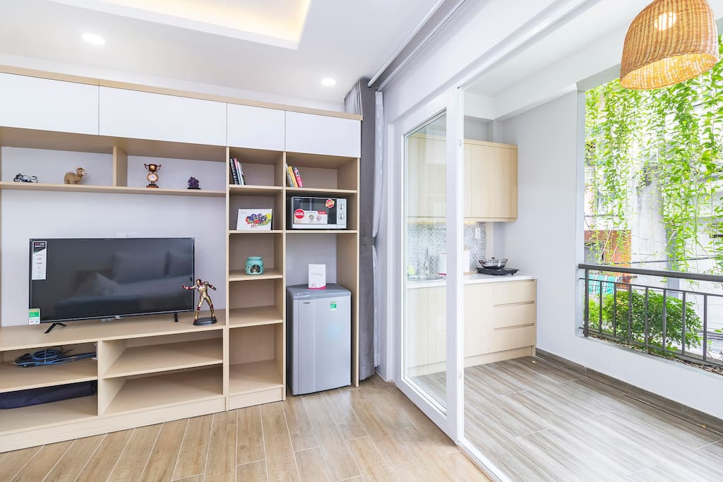 The kitchen is outside the bed-living space, for better ventilation and cooking vibe
