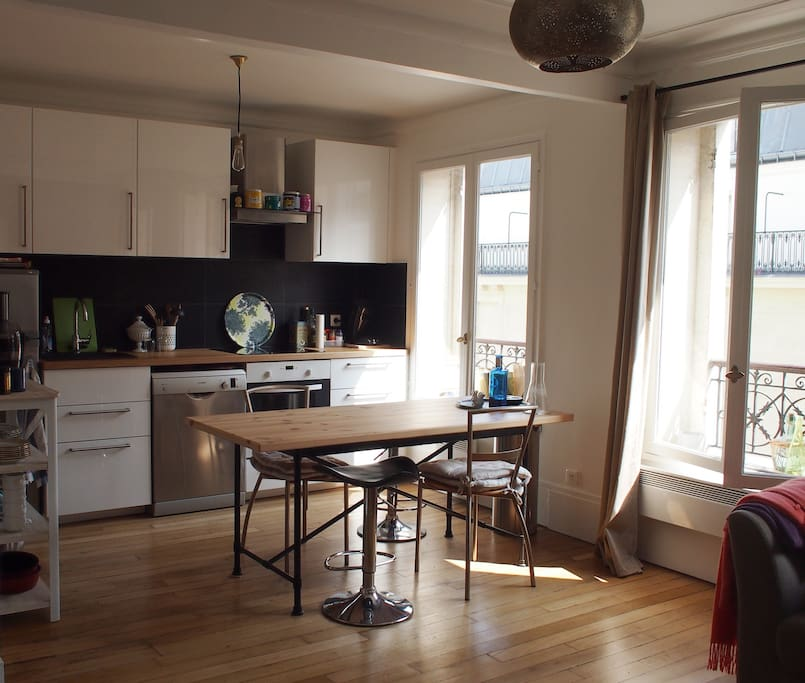 Sunny kitchen with dining table