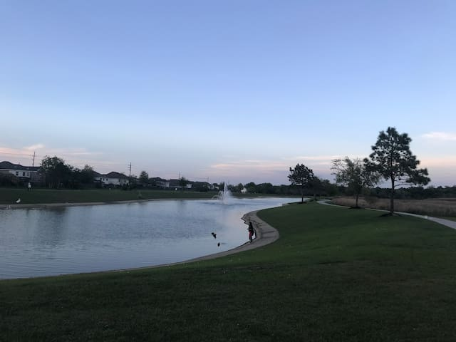 Neighborhood lake with jogging trail and playground