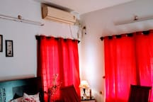 Master bedroom with AC and windows view