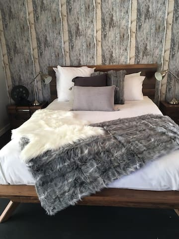 Snuggle in to the inviting queen bed