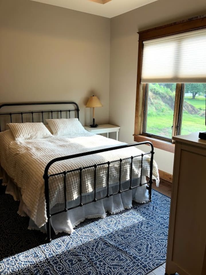 Guest room with tons of natural light.