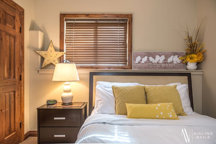 The downstairs yellow room features a queen bed  that will have you waking up feeling like a star.