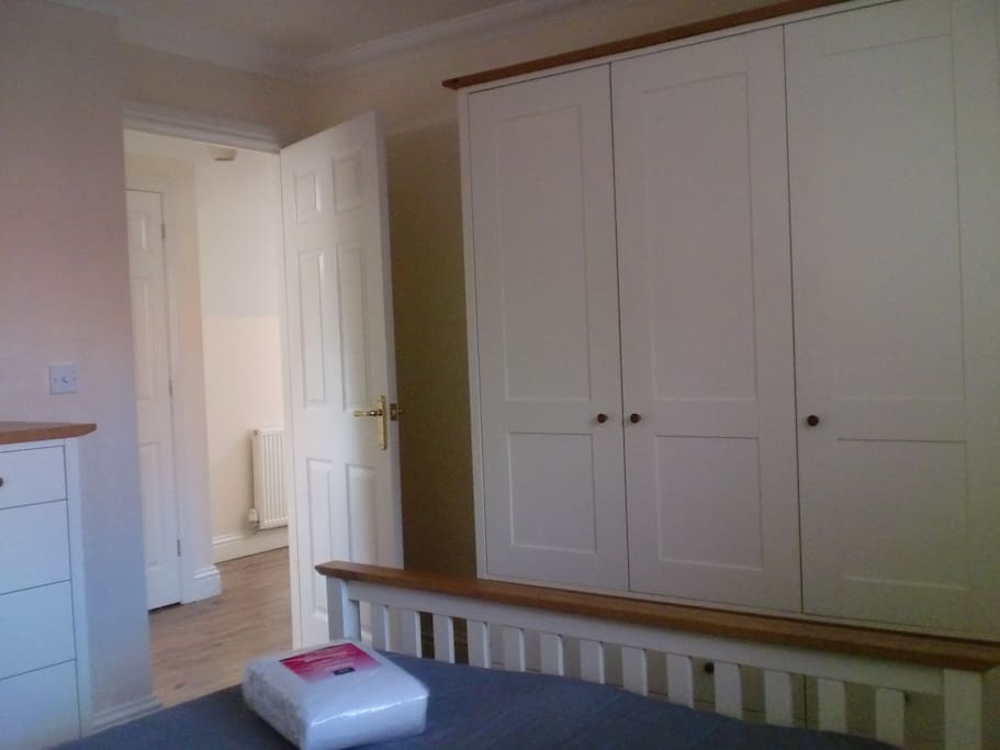 Double bedroom with a wardrobe which has drawers as well as hanging space and drawers