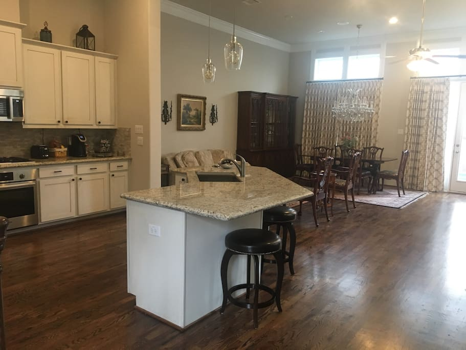 Open living space with 12 ft ceilings and an abundance of light adjacent to backyard with swim spa for entertaining. 65 in flat screen TV with surround sound.