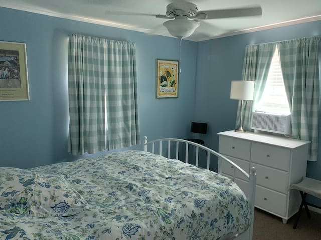 Queen bed with new mattress and temper pedic cool mattress topper.  (This room has locked closet for owners belongings)  Plenty of hanger space and hangers behind door on wall and on back of door.