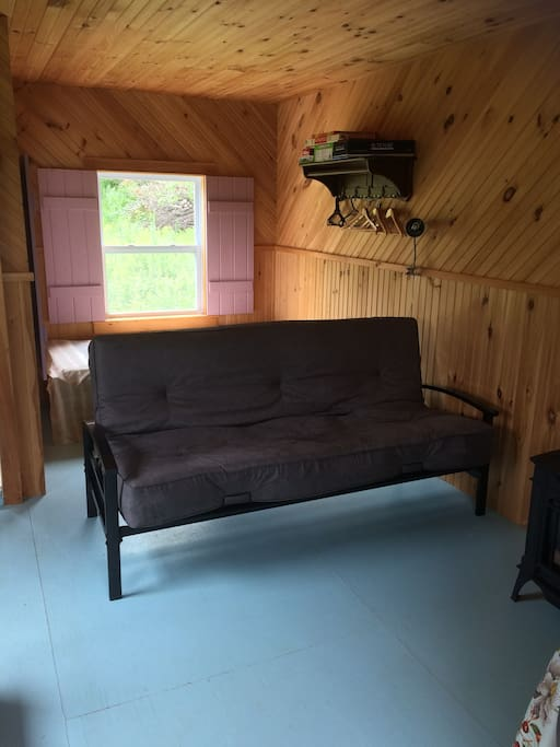Futon for 2 and 2 single beds behind it