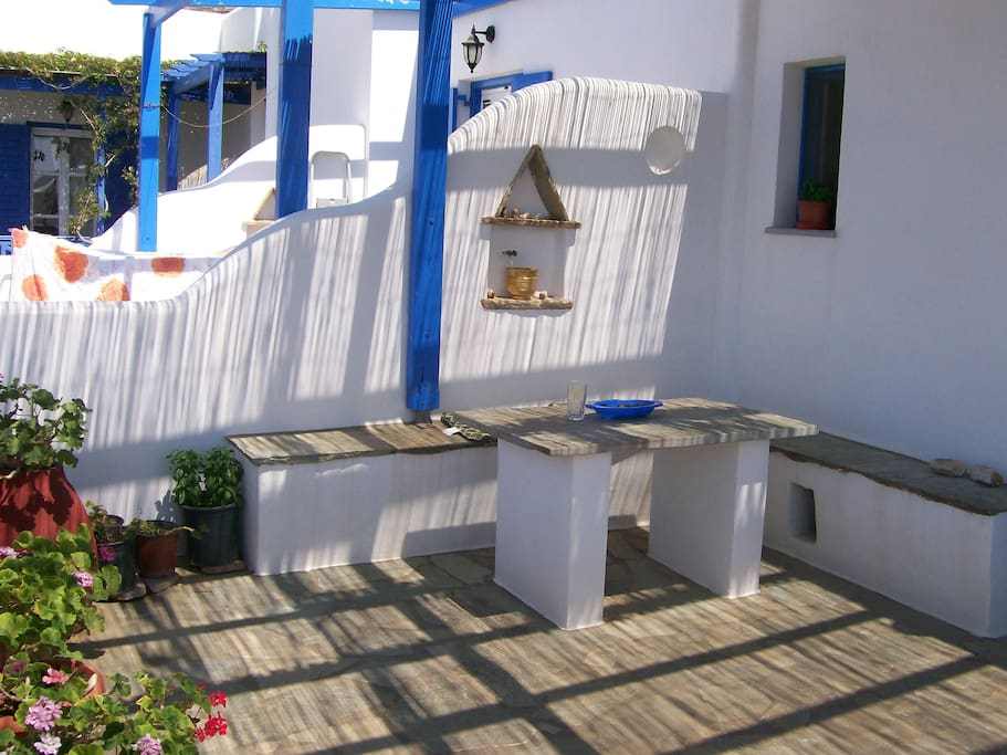 Terrasse with bench and table for meals with  a view