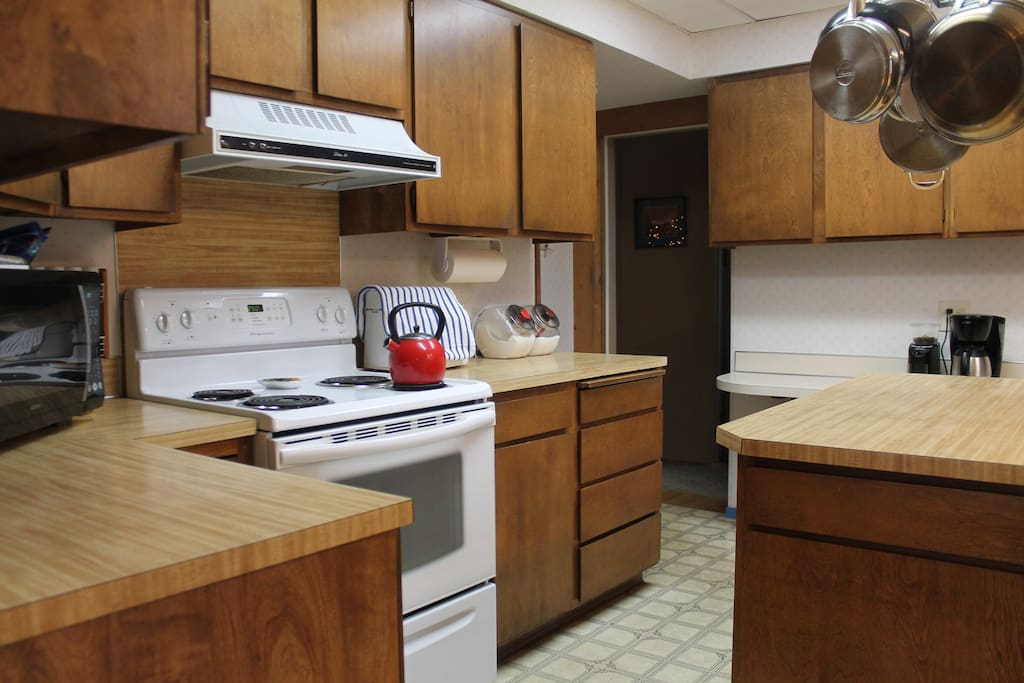 You'll walk through our lovely kitchen to get upstairs to your room.