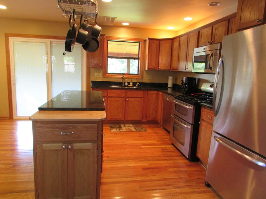 Well equipped kitchen with stainless steel appliances.