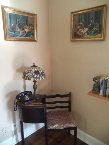 Matching paint by numbers, fake tiffany lamp, vintage phone and gossip chair.