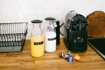 Nespresso machine & milk frother with complimentary milk, OJ & breakfast supplies to help you relax and kick back in the morning!